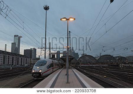 FRANKFURT, GERMANY-JANUARY 07, 2018: DB train at sunset waits at the Frankfurt main train station for the departure, Germany
