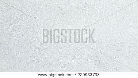 Grungy white painted wall texture as background. Cracked concrete vintage white wall background, old painted wall. Background white painting