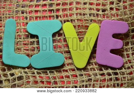 word live on an  abstract colored background