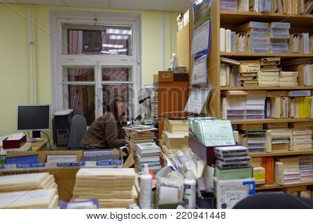 ST. PETERSBURG, RUSSIA - NOVEMBER 22, 2016: Staff of the St. Petersburg state library for the blind and visually impaired people in the fulfillment department during the program Tactile Library