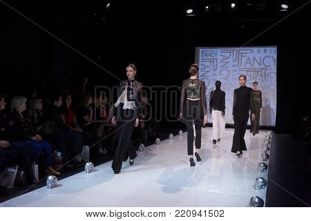 ST. PETERSBURG, RUSSIA - DECEMBER 5, 2015: Collection of fashion holding Fabric Fancy at the fashion show during St. Petersburg Fashion Week Overview. The event sums up the year