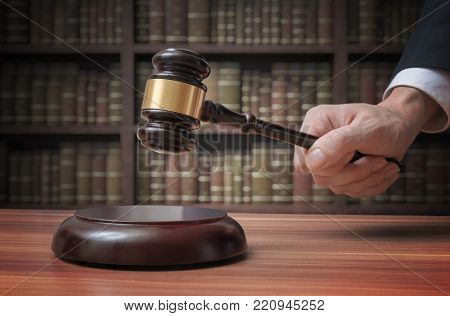 Justice and law concept. Lawyer is hitting with gavel.