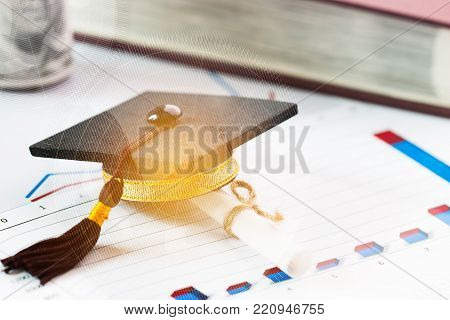Graduate study international abroad concept, Graduation cap, scroll certificate near on documents report chart. Graduate study abroad program for students foreign county, Study abroad lead to success