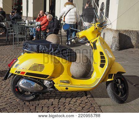TURIN, ITALY - CIRCA JANUARY 2018: yellow Italian Vespa scooter motorcycle