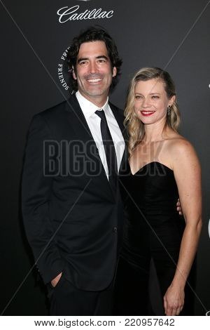 LOS ANGELES - JAN 6:  Carter Oosterhouse, Amy Smart at the The Art of Elysium presents John Legend's HEAVEN at Barker Hanger on January 6, 2018 in Santa Monica, CA