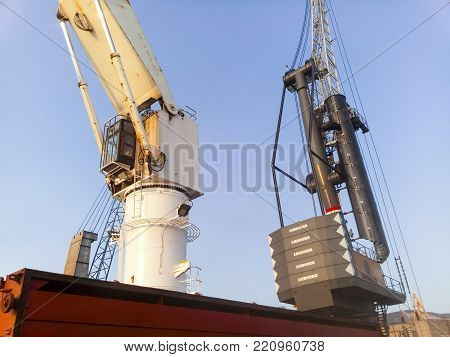 Novorossiysk, Russia - August 20, 2017: Crane on a cargo ship in the port