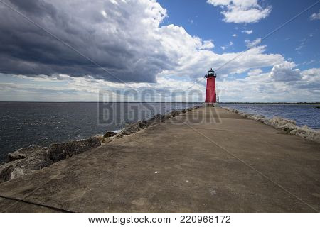 Summer Lighthouse Background. Manistique Michigan Lighthouse under a beautiful blue summer sky. Upper Peninsula, Michigan, USA.