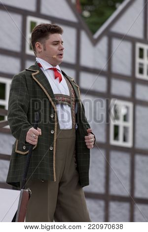 ST. PETERSBURG, RUSSIA - JULY 19, 2017: Singer Artem Melikhov in the opera The Marksman of C. M. von Weber outdoors during the festival All Together Opera. It was third of 4 performances