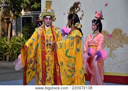 CANTON, CHINA - CIRCA DECEMBER 2017: The three singers of Cantonese opera during their performance.