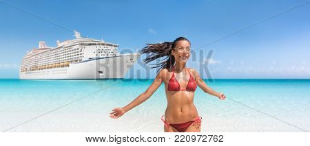 Cruise ship travel Caribbean vacation bikini woman happy on tropical holidays swimming in blue ocean water. Joyful Asian girl with open arms in freedom enjoying luxury getaway.