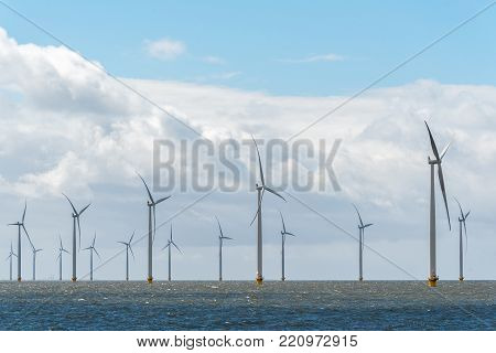 Large view on the windmills in the ocean