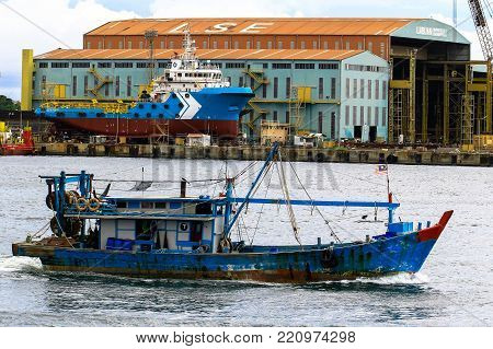 Labuan,Malaysia-Aug 30,2017:Traditional fishing boat and vessel in the dock dry under repairing in shipyard at Labuan,Malaysia.