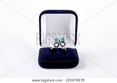 Men elegant french cuffs in velour box. Silver cuff-links with blue stripes in velour box, isolated on white background. Men luxury accessory.