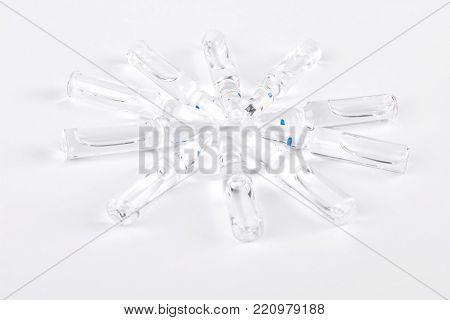 Glass ampules with liquid medicine. Break-seal glass ampoules with liquid for injection on white background.