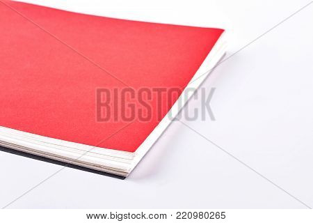 Spiral binder notebook, white background. Red paper notebook isolated on white background.