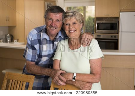 senior beautiful middle age couple around 70 years old smiling happy together at home kitchen looking sweet in lifetime husband and wife enjoying life and love concept