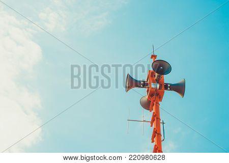 vintage horn speaker - public relations sign and symbol. vintage color tone effect