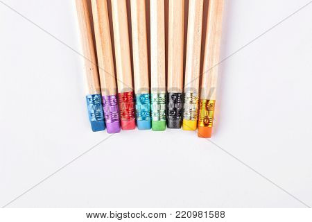 Set of pencils with erasers. Row of simple pencils isolated on white background, cropped image.