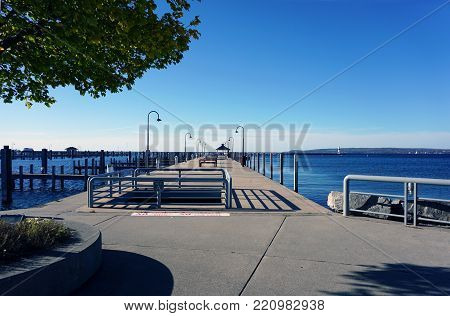 PETOSKEY, MICHIGAN / UNITED STATES - OCTOBER 18, 2017: Boats may dock at Pier A, in the Petoskey Municipal Marina, adjacent to Petoskey's Bayfront Park.