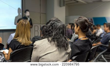 Business People Conference Speaker on over the Abstract blurred photo of seminar room with attendee background, business seminar and education concept