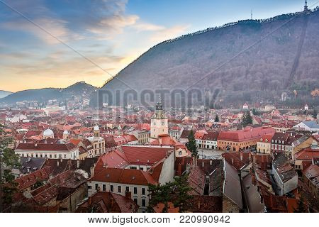 Brasov, Transylvania, Romania - Novemrer 19, 2016: the central square of the old town. Brasov. Transylvania. View from above. The buildings, the people on the square like little ants. An interesting effect