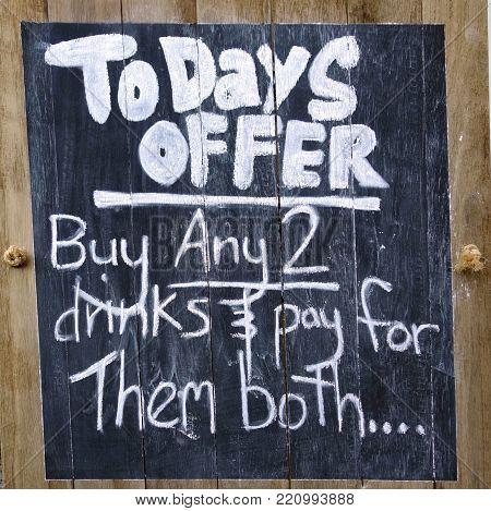 A novelty sign mounted outside a bar