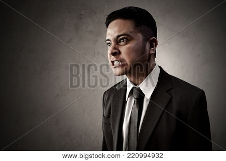 Asian business man angry and hate expression