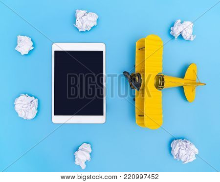 Blank Empty tablet with yellow plane on blue and white cloud paper sky for travel concept