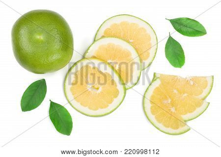 Citrus Sweetie or Pomelit, oroblanco with slices and leaf isolated on white background close-up. Top view. Flat lay.