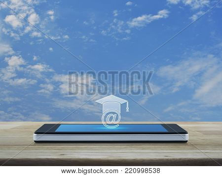 e-learning icon on modern smart phone screen on wooden table over blue sky with white clouds, Study online concept