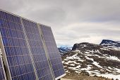 Renewable regenerative power and eco energy. Photovoltaic solar panel outdoor in norwegian mountains nature. System of electricity generation. poster