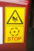 Warning sign on agricultural machinery. Open the protective covers and inspection hatches only at idle harvester and stopped the drives. poster