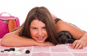 smiling brunette teenage girl in swimsuit at the beach with her shipoo dog (studio setting with beach and personal items) isolated on white background poster
