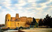 Exterior view to Ota-Darvoza gate and Statue of Muhammad ibn Musa al-Khwarizmi at Khiva, Uzbekistan poster