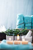 Spa and wellness setting with flowers and towels. Dayspa nature products poster