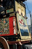 Traditional wooden float covered with tapestries being pulled by ropes at the Otsu Matsuri festival in Otsu town near Lake Biwa Japan. The Otsu Matsuri is a famous yearly event held in October in the town of Otsu in Shiga prefecture. poster