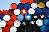 Multi-coloured oil barrels stacked up for cargo poster