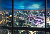 Night scene cityscape shoot from window internal building in Bangkok metropolis Thailand poster