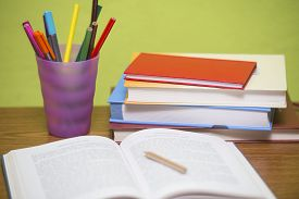 Study table with pencils and other accessories