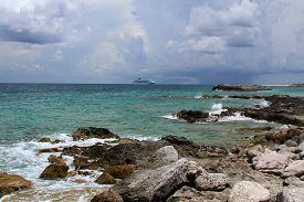 Rocky Coastline and a storm on the horizon at Coco Cay located in the Bahamas.