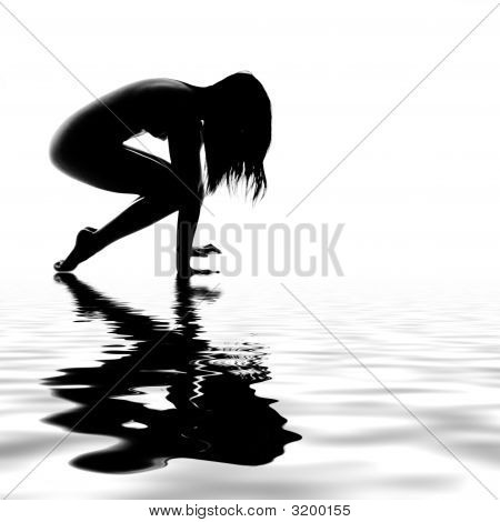 Asian Model Stretching By The Water