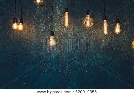 Light Bulb Edison Filament Retro Vintage Decor On Brick Wall Background. Lighting Decoration.