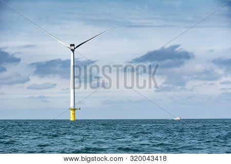 Wind Turbine Out At Sea On Sunny Day
