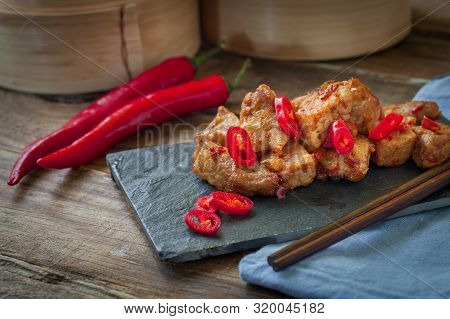 Chinese Chicken Breast With Chili Sauce And Chopstick