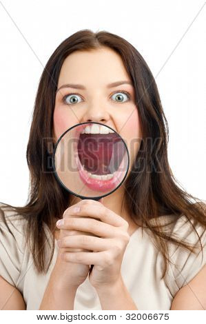 Portrait of young caucasian woman with magnifying glass showing her teeth