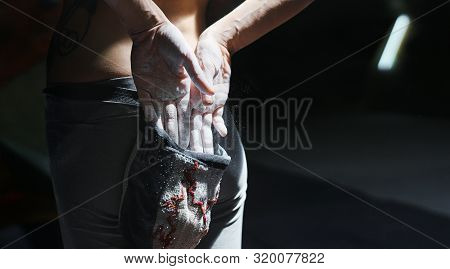 Woman Climber Is Chalking Hands With White Chalk Powder Before Climb In Indoor Climbing Gym. Woman G