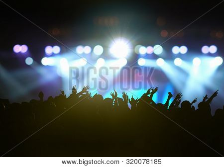 Concert Crowd In Silhouettes Of Music Fanclub With Show Hand Action Which Follow Up The Songer At Th