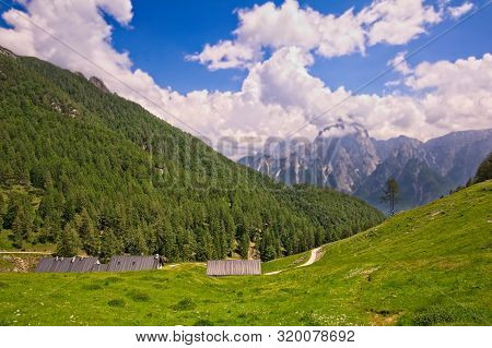 Mountain Panorama With Dirty Road,trees And Blue Sky With Clouds.