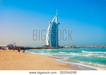 Dubai, Uae - February 27, 2019: Burj Al Arab Luxury Hotel And Jumeirah Public Beach In Dubai City In