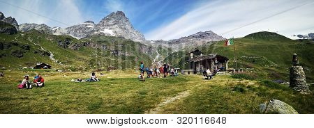 Breuil-cervinia, Italy  - August 16, 2019: Tourists At The Church Of The Aosta Battalion Of The Alpi